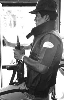 Salvadoran guards our bus door during civil war